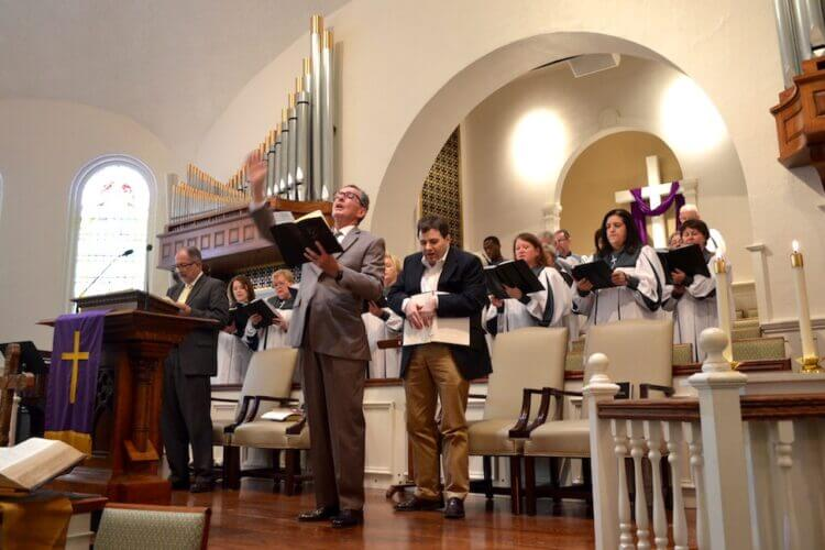 Photo of Henry leading a hymn